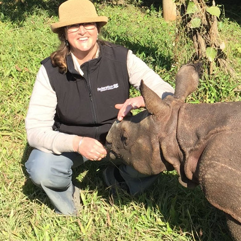 Wendy Wright with a juvenile rhinoceros