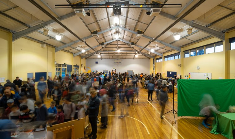 School hall filled with people for STEM displays